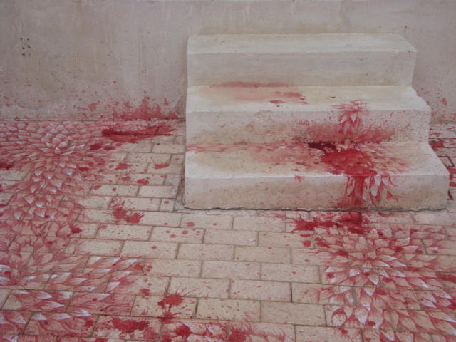 Imran Qureshi, Blessings Upon The Land of My Love, 2011, acrylic and emulsion paint on interlocking brick pavement, site-specific installation. Installation view, Sharjah Biennial 10 (2011). Photograph: Alfredo Rubio. Courtesy Corvi-Mora, London