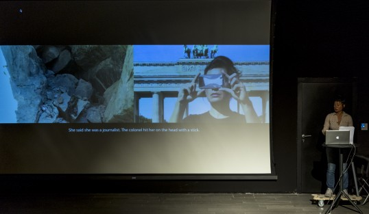 Hito Steyerl, Is a museum a battlefield?, 2013, video of performance, 36min. Photograph: Servet Dilber. Courtesy the artist and the Public Program of the Stedelijk Museum, Amsterdam